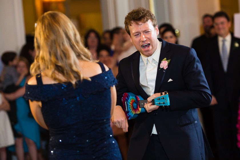 Groom plays a tie dye ukelele and sings to his mother