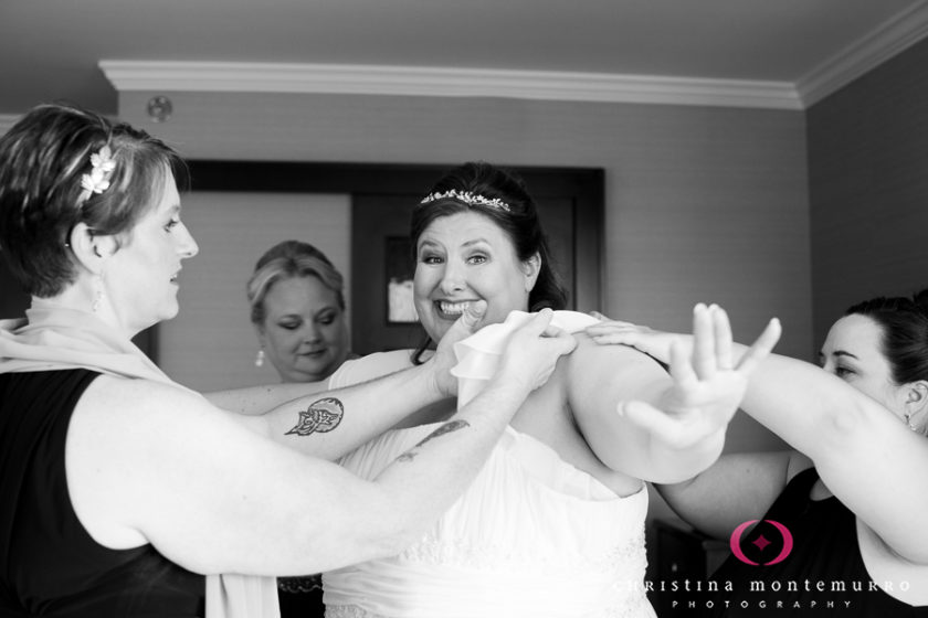 Smiling happy bride getting ready at the Wyndham Grand