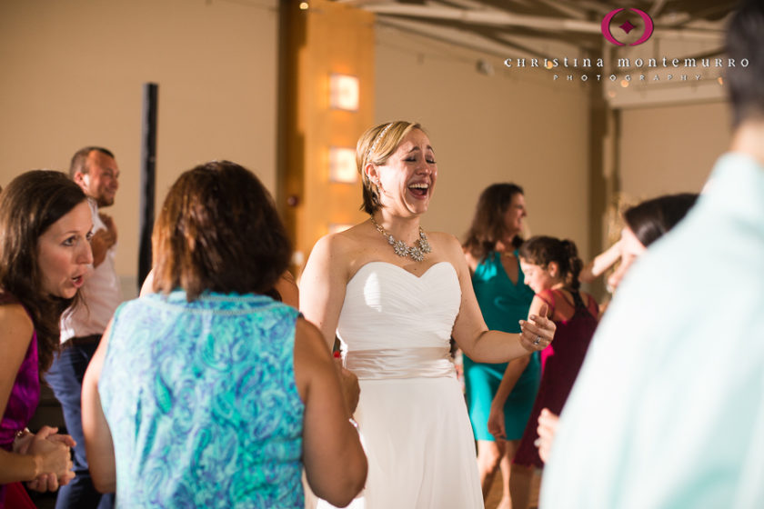 Happy bride dancing at their wedding reception at the Heinz History Center Mueller Center