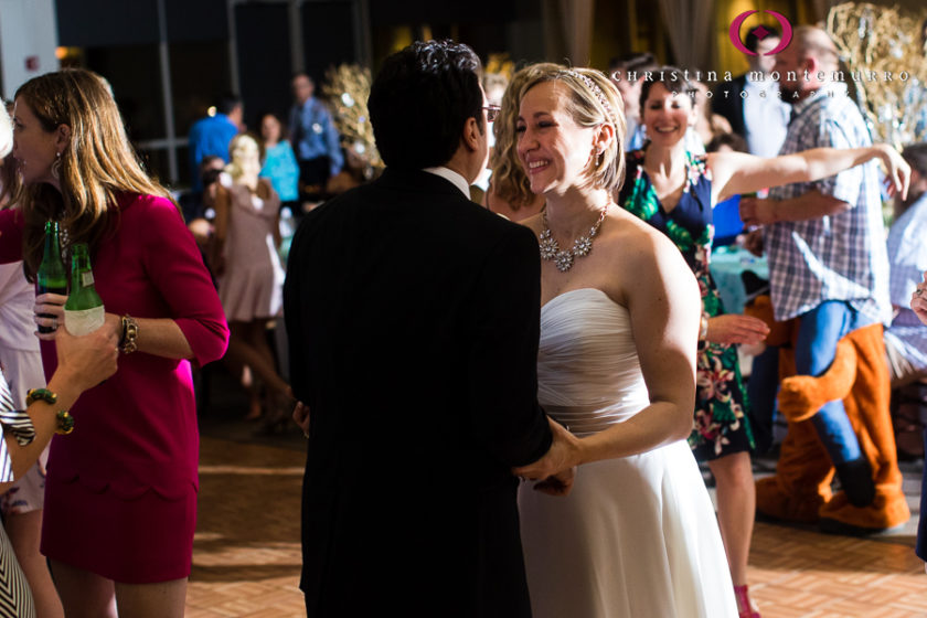 Happy bride and groom dancing at their wedding reception at the Heinz History Center Mueller Center