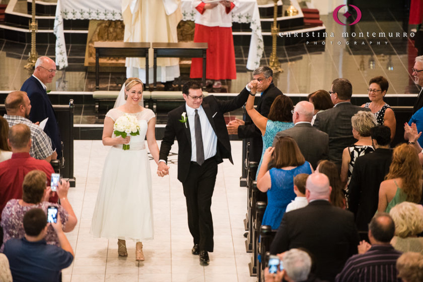 Happy Bride and Groom walking down the aisle after their wedding at Saint Peter in Pittsburgh