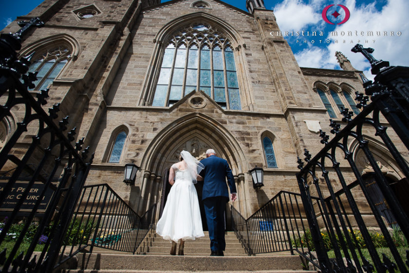 Bride and her father walking into the church for her wedding atSaint Peter Parish Pittsburgh