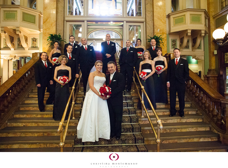 Bridal Party at Grand Concourse Staircase Pittsburgh Wedding Photography red and white bouquets and red vests black bridesmaid dresses