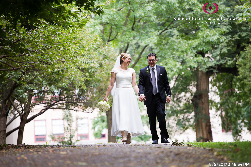 Bride and Groom Walking near the National Aviary in Pittsburgh