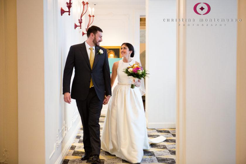 Kimpton Hotel Monaco Pittsburgh Wedding Photos Bride and Groom walking through quirky hotel