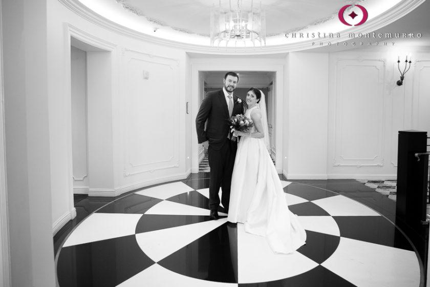 Kimpton Hotel Monaco Pittsburgh Wedding Photos Bride and Groom Portrait in lobby with black and white geometric floor