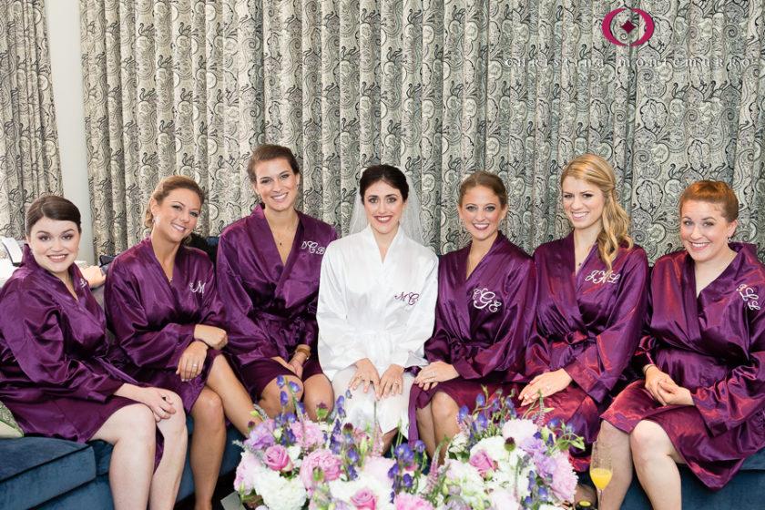 Kimpton Hotel Monaco Pittsburgh Wedding Photos Bride and Bridesmaids Purple Monogrammed Robes