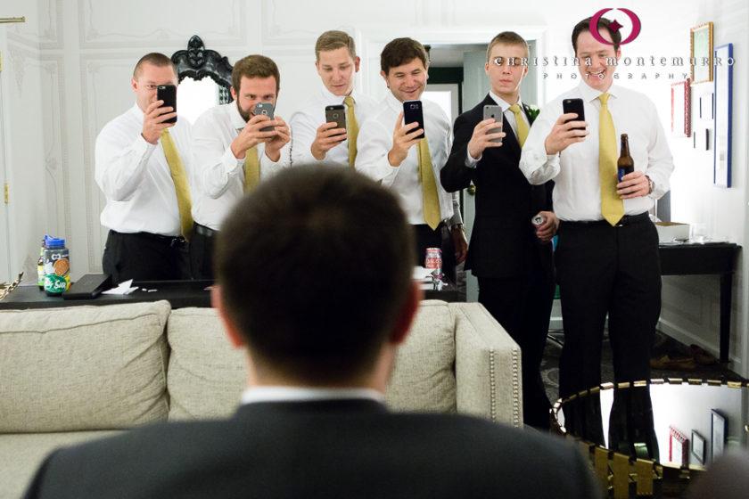 Kimpton Hotel Monaco Pittsburgh Wedding Photos Groom and Groomsmen with Camera Phones