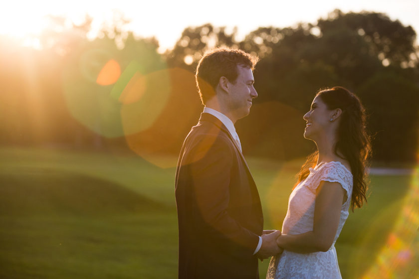 Bride and Groom at Sunset on Golf course