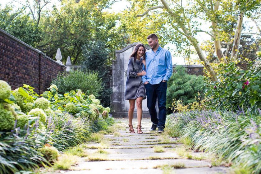 Couple walking next to Mellon park walled garden