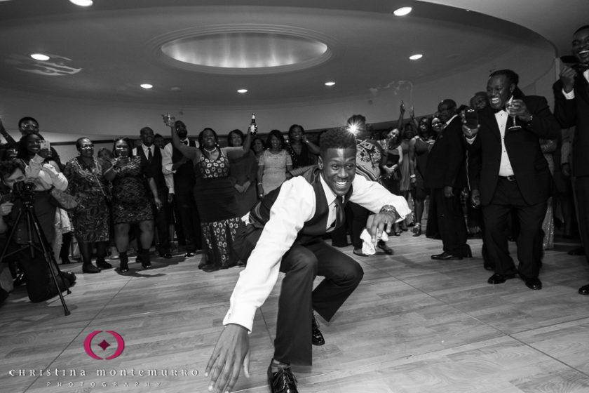 Groomsmen dancing at wedding reception