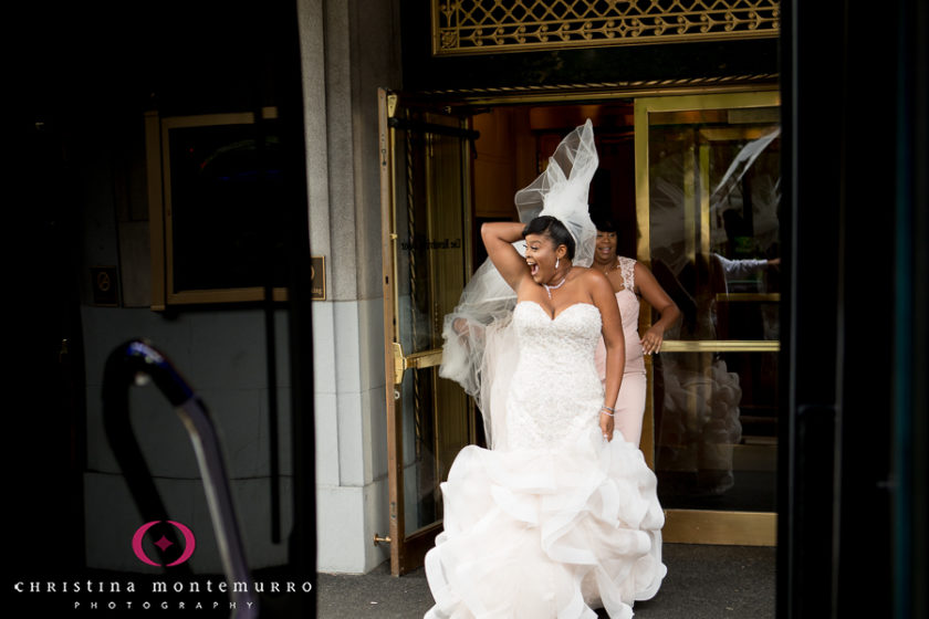 Bride leaving the Omni Wedding Penn on a windy summer day