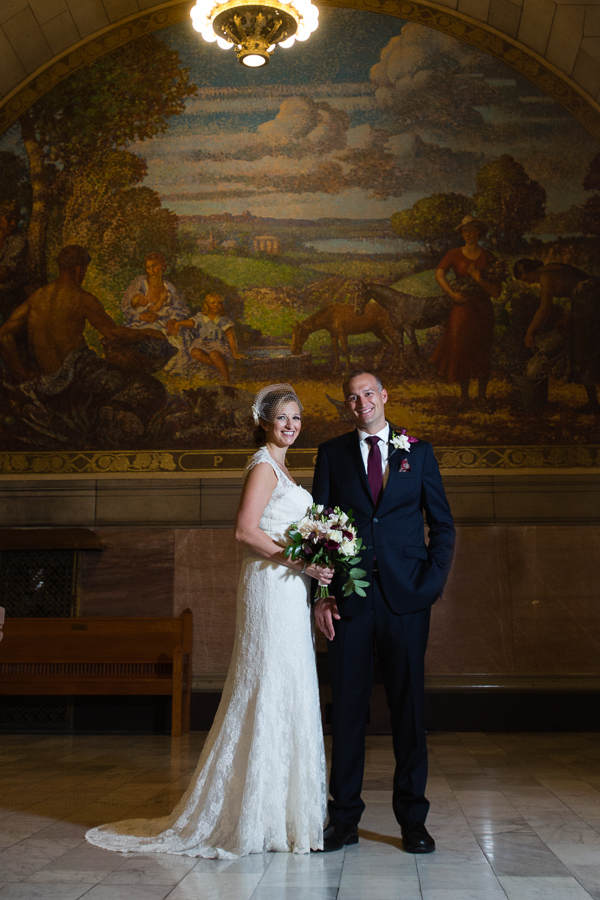Bride and Groom in front of a Coloful Pastoral Mural at the Allegheny County Courthouse