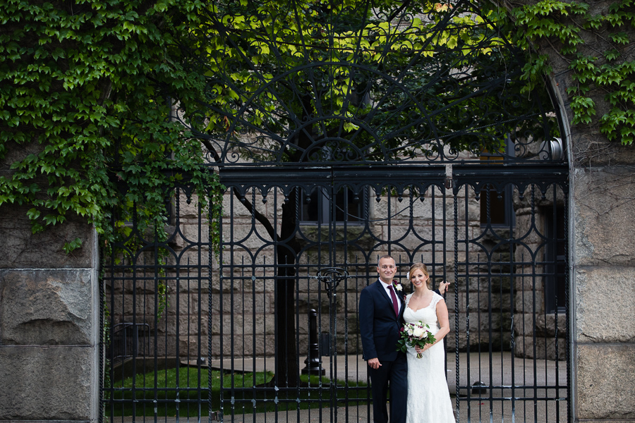 Bride and Groom in front of Ivy Covered Gate at the Allegheny County Courthouse