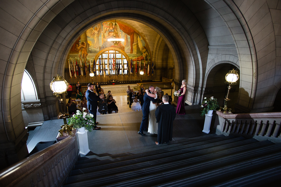 Bride and Groom first kiss at the end of their wedding ceremony at Pittsburgh Courthouse