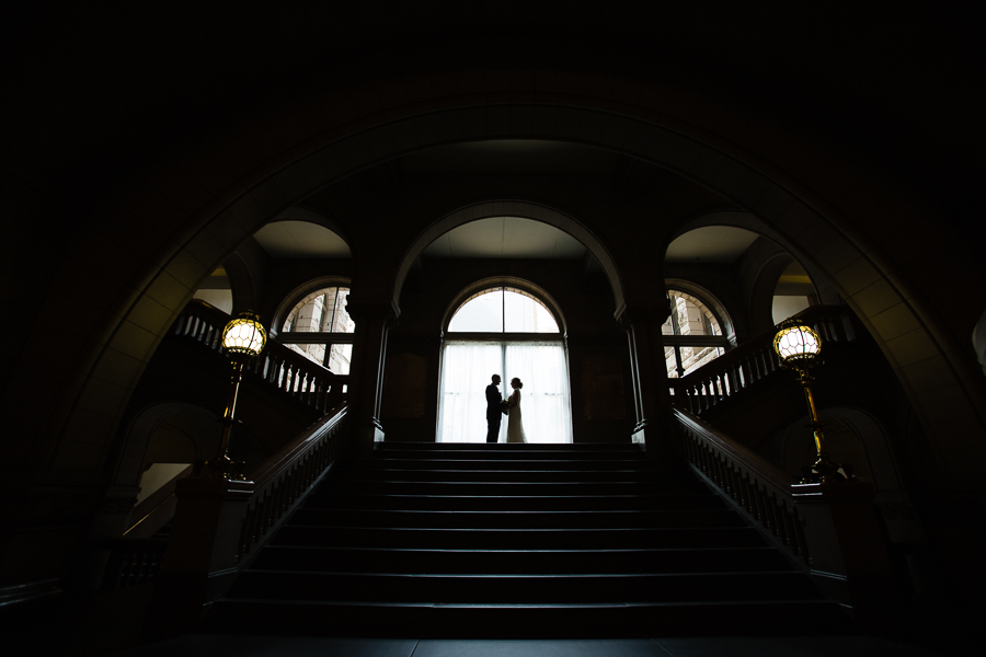 Bride and Groom Silhouette in front of the Windows in the Courthouse in Pittsburgh