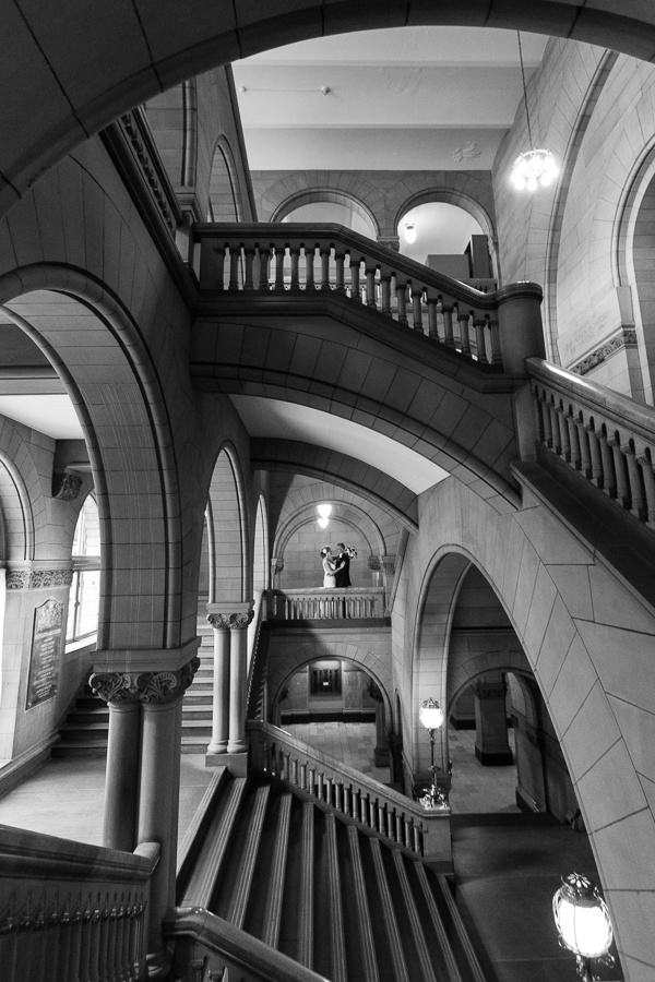 Bride and Groom in Beautiful Stone Architecture with Staircases in Pittsburgh Courthouse