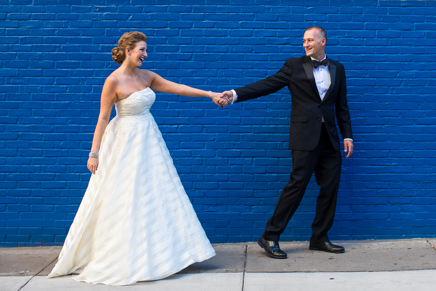 Bride and Groom in front of Bright Blue Brick Wall in Downtown Pittsburgh