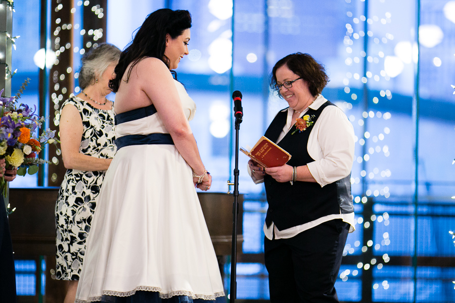 Bride Reading Vows inside Catcher in the Rye Book at Library Wedding