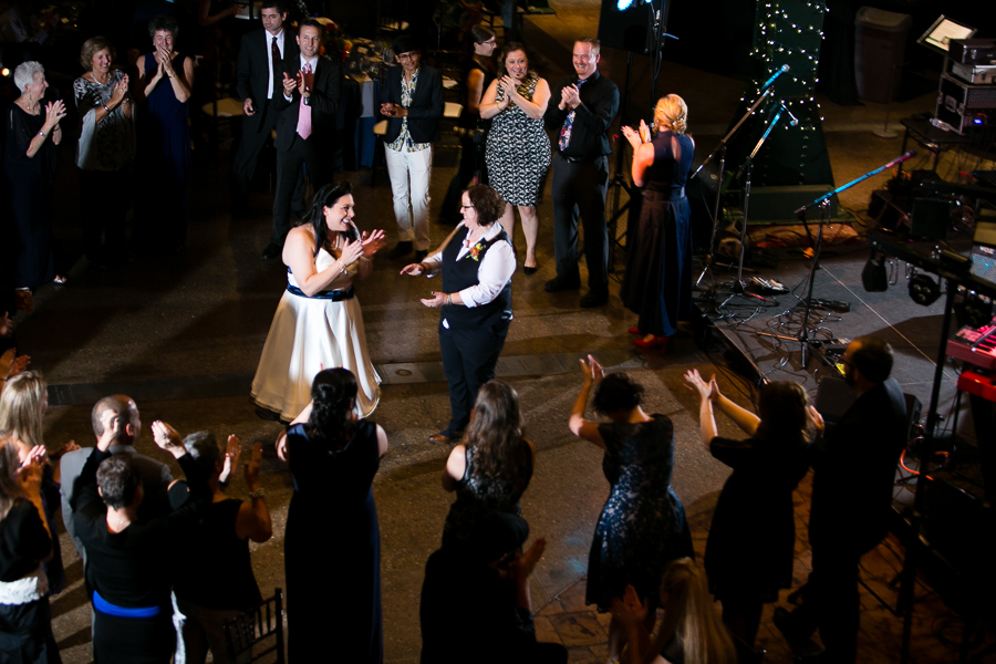 Brides in the Center of a Circle of Guests on the Dance Floor in the Great Hall