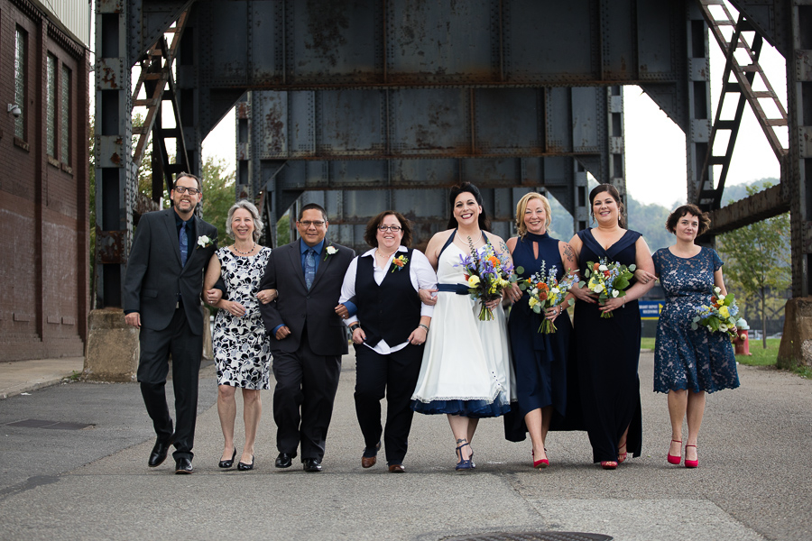 Bridal Party Entourage with Two Brides in Pittsburgh Strip District under Railroad Bridge