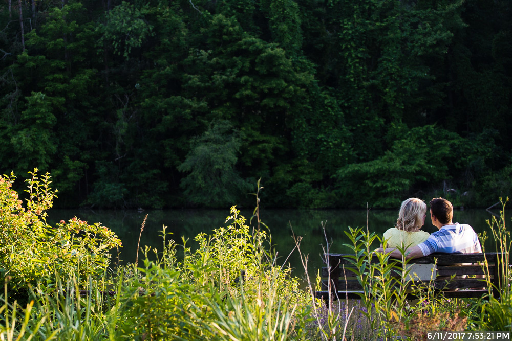 Couple Sitting on a Bench by Marshall Lake in North Park Pittsburgh