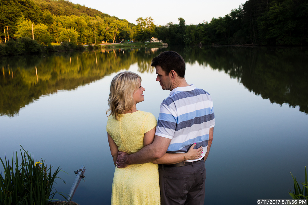 Bride to Be in Yellow Dress with Fiance Standing by Marshall Lake in North Park Pittsburgh