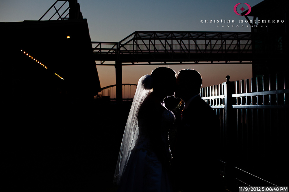 Bride and Groom Kissing at Twilight in Station Square