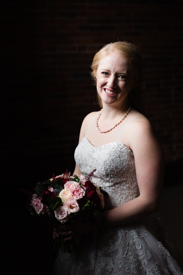 Classic Portrait of Beautiful Bride in Strapless Dress with Bouquet by Blue Daisy Floral Designs