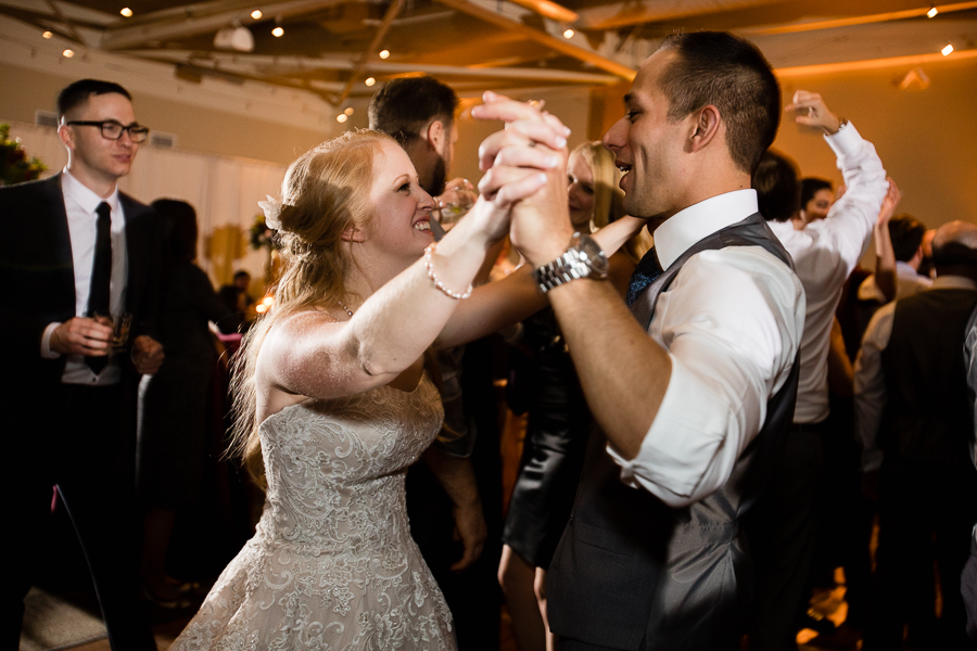 Bride and Groom Dancing together at Reception with Move Makers Band