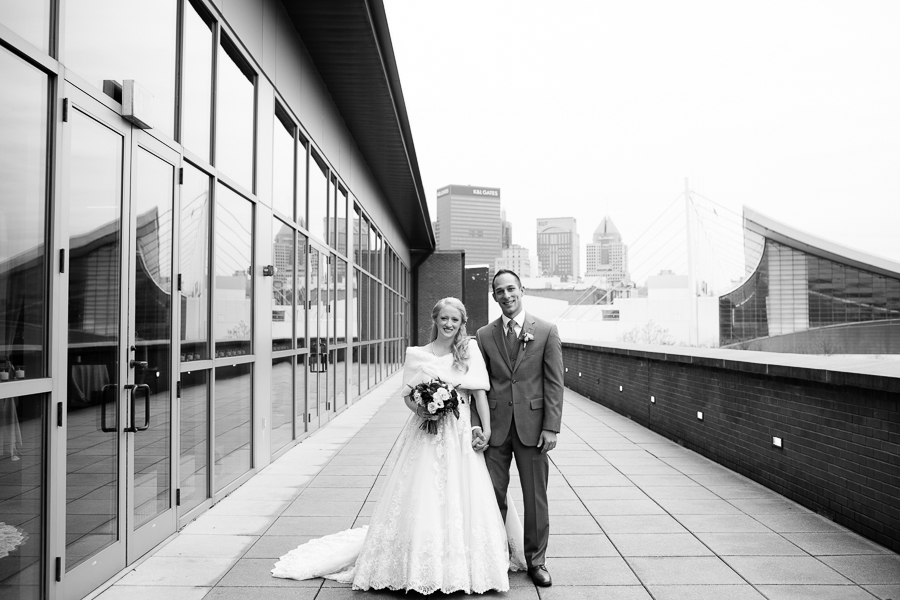 Bride with White Fur Wrap and Groom in Gray Suit on Heinz History Center Balcony