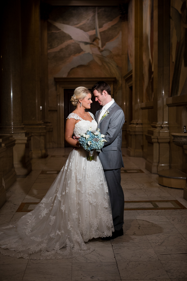 Elegant Bride and Groom at the top of the Carnegie Museum Grand Staircase
