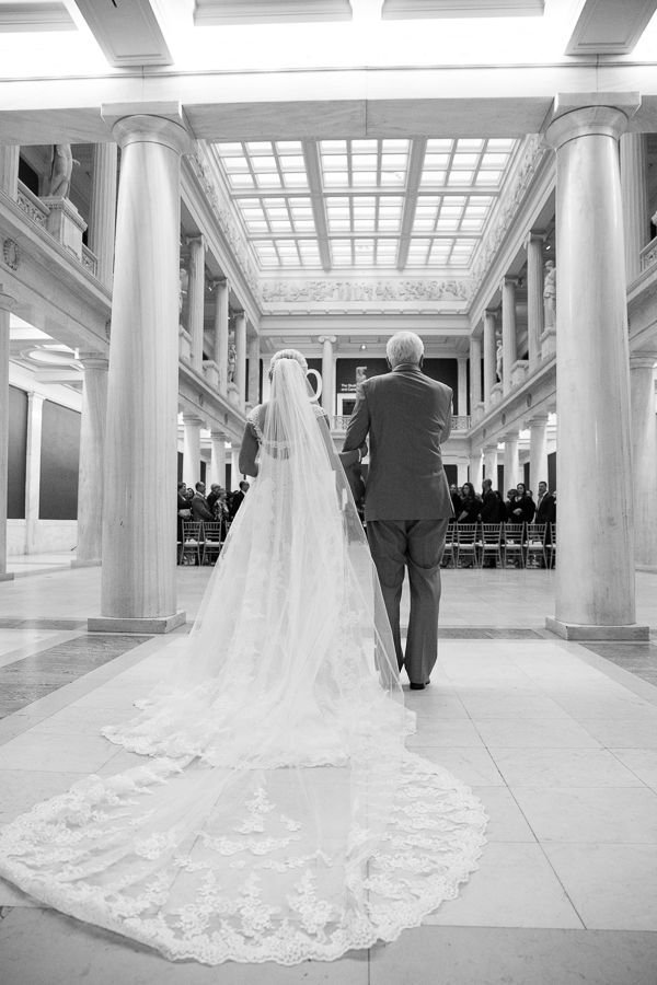 Beautiful photo of Bride and her father about to walk into wedding ceremony at the Hall of Sculpture Carnegie Museum