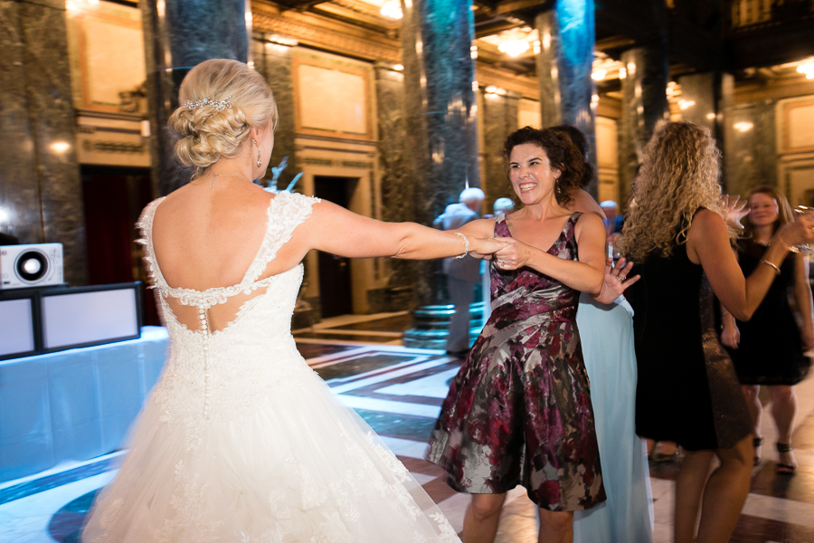 Bride Dances with her Friend at the Carnegie Music Hall foyer