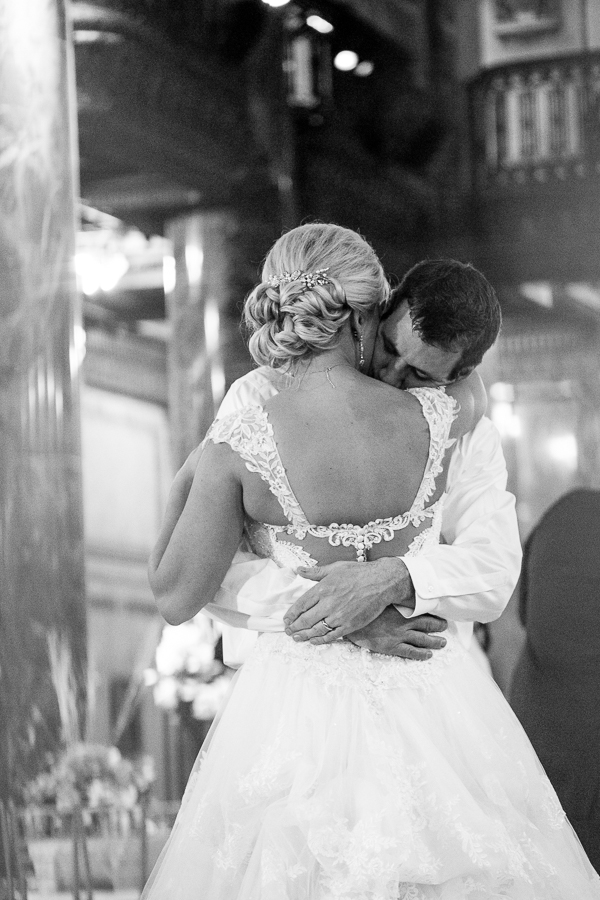 Bride and Groom Hug at the end of their wedding reception at the Carnegie Music Hall Foyer