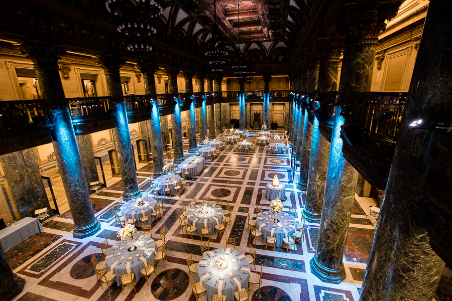 The stunning Carnegie Music Hall Foyer Wedding Reception with Blue Uplighting and Light Blue Linens