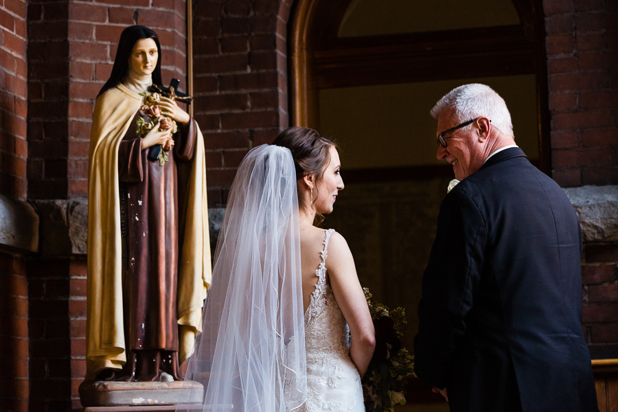 Bride and her dad right before her wedding at St. Joseph Chapel