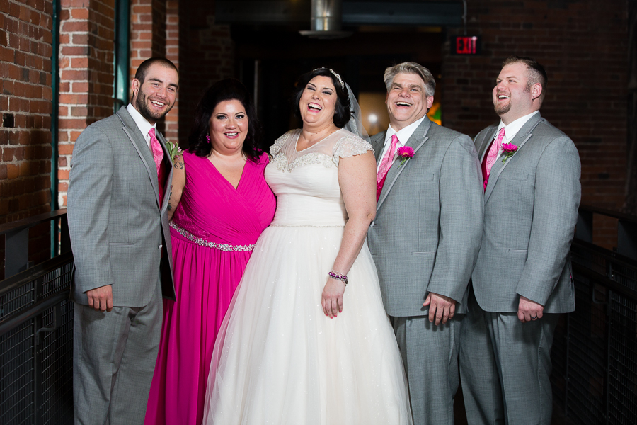 Bride with Maid of Honor in Bright Pink Dress and Groomsmen with Gray Suits and Pink Ties