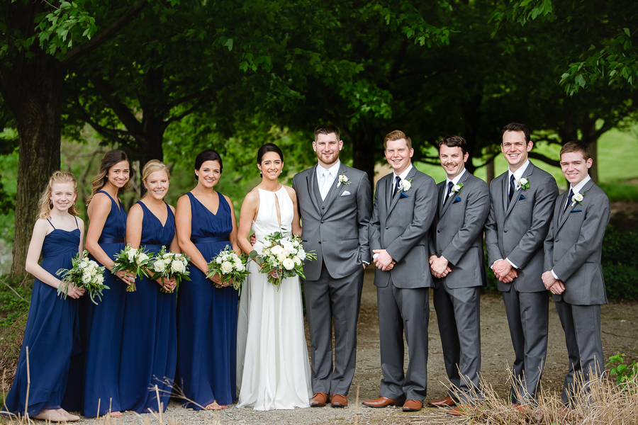 Bridal Party with Dark Blue Dresses and Gray Suits