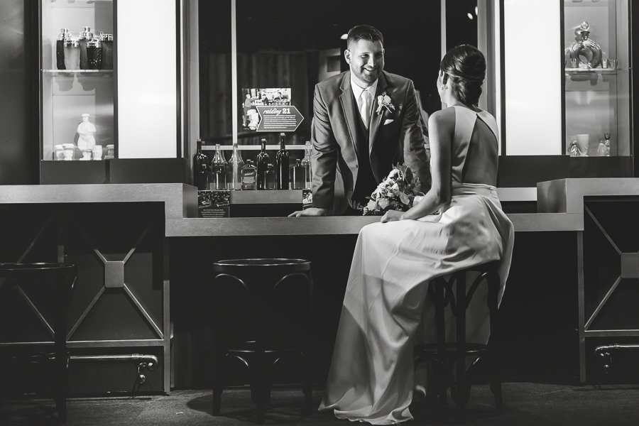 Bride and groom portrait in prohibition speakeasy exhibit at the Heinz History Center
