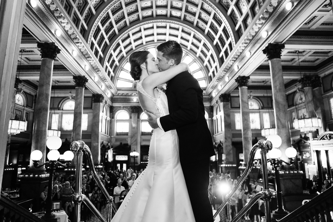 Bride and Groom Kiss Before they Enter their Reception at the Grand Concourse Pittsburgh