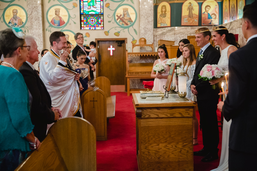 Bride and Groom Circle the Altar at Greek Orthodox Wedding