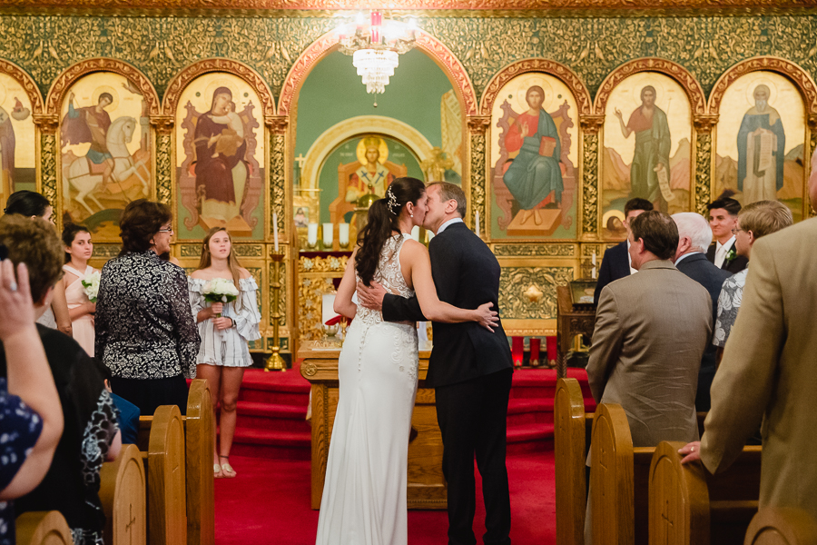 Bride and Groom Kiss at Greek Orthodox Wedding