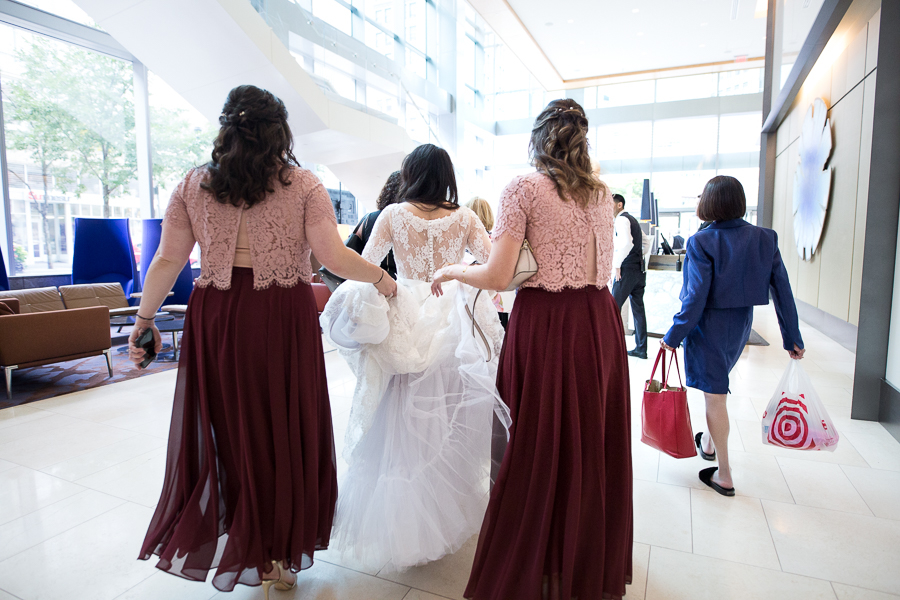 Bride and bridesmaids walking through the lobby of the Fairmont