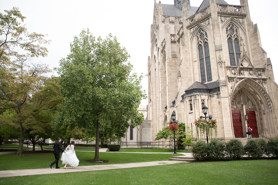 Bride and groom walking toward Heinz Chapel