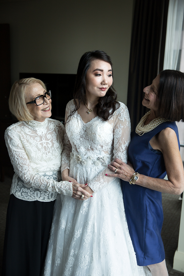 Bride with her mother and grandmother before her wedding