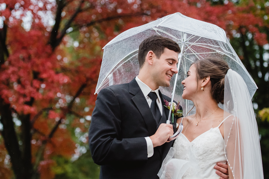 Bride and Groom with Clear Umbrella on a Rainy Day atEdgewood Country Club Wedding