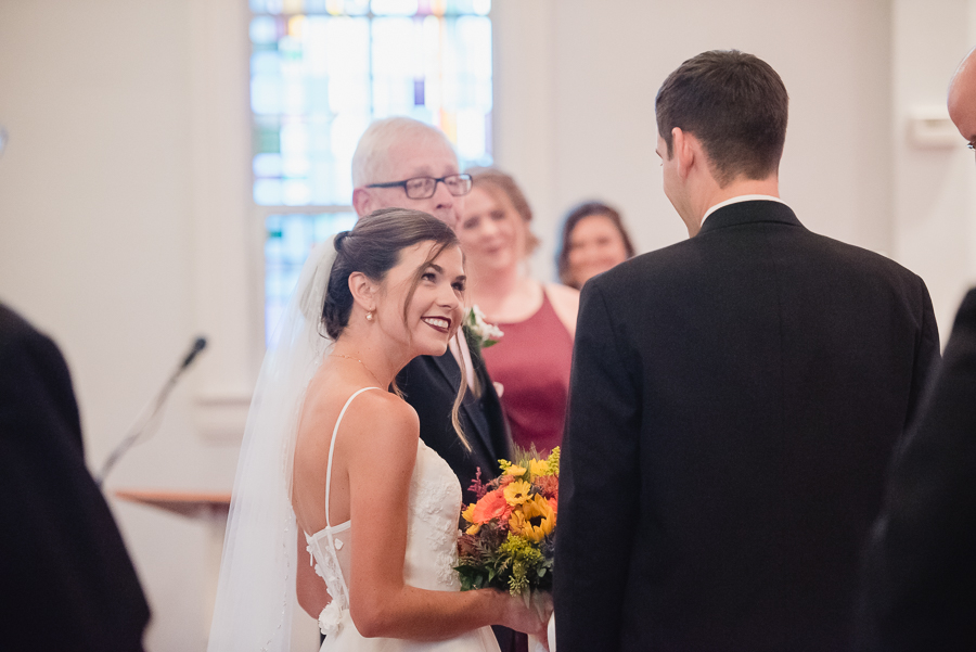Bride Smiling at Groom at Wedding Ceremony