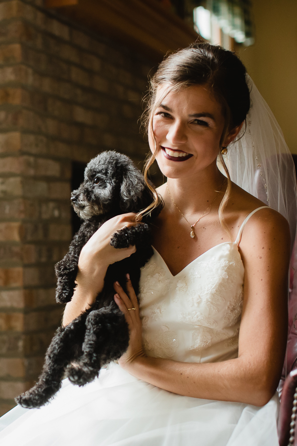 Bride with her adorable little black dog