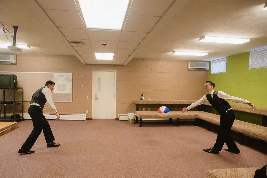 Groom and Groomsmen playing with beach ball